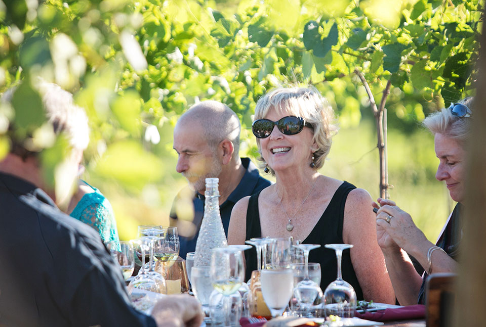 Diner Smiling at Dinner in the Vineyard